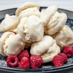 Ever wondered how to make cream meringues? Easy to make and delicious. Try this cream meringue recipe and you'll be enjoying these wonderful creamy sweet bombs in no time. Yum! | theyumyumclub.com