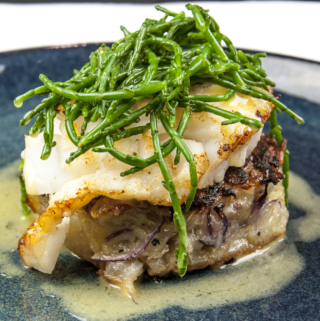 Pan fried cod with classic beurre blanc sauce. This is a fantastic recipe and very versatile with how it can be served. I placed the cod on a potato rosti and topped it with samphire. Seafood with vegetables from the sea. Yum! | https://theyumyumclub.com