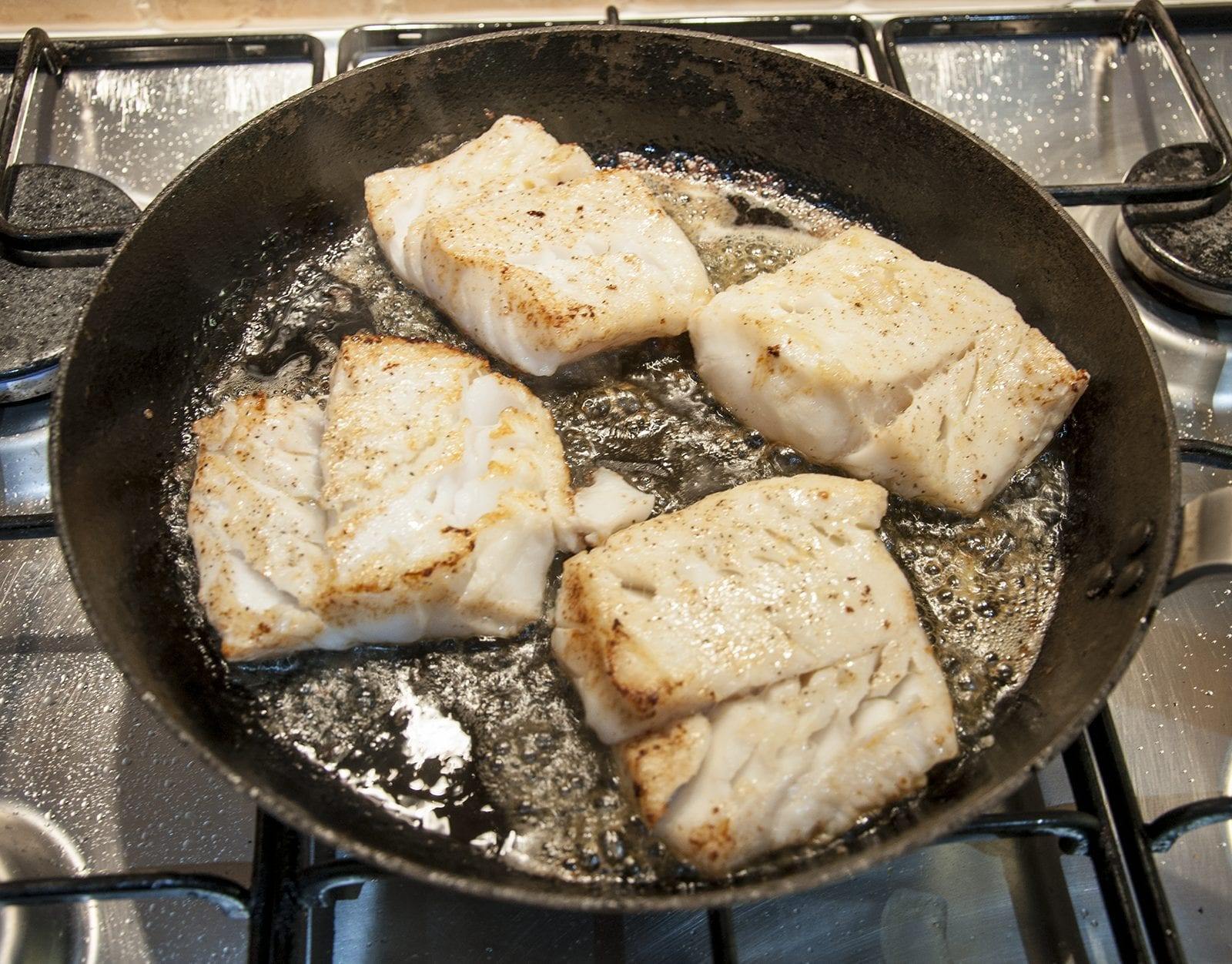 Pan fried cod with classic beurre blanc sauce. This is a fantastic recipe and very versatile with how it can be served. I placed the cod on a potato rosti and topped it with samphire. Seafood with vegetables from the sea. Yum!   https://theyumyumclub.com