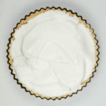 Lemon meringue pie! What a classic. Lovely sweet meringue, zesty sharp lemon, and a melt in the mouth pastry. Yummy! | https://theyumyumclub.com