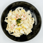 Classic smoked haddock and prawn tagliatelle. What a stunning seafood recipe. The smokiness of the poached haddock sauce. Fantastic, and healthy too. Yum! | theyumyumclub.com