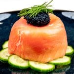 Just look at this individual smoked salmon terrine. I love this recipe. So tasty and a dish that will impress your friends at any dinner party. Hot and cold smoked salmon, cream cheese with chives, and even topped with a little caviar. Yum! | theyumyumclub.com