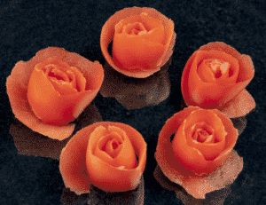 How to make tomato roses. A lovely and classy garnish for any dish. So simple to create. See how to make these pretty tomato flowers in this easy tutorial. | theyumyumclub.com