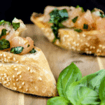 Enjoy the taste of Italy in this homemade bruschetta. Wonderful garlic, tomato concasse, basil, and extra virgin olive oil. Make the bread too if you like! | theyumyumclub.com