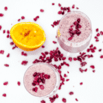Pomegranate and banana smoothie. A super smoothie recipe made with almond milk, orange juice, and just a touch of cinnamon. A great start to the day. Yum!! | theyumyumclub.com
