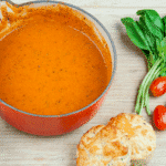 Traditional and classic tomato and basil soup. What a recipe! Tasty, creamy and at only 169 calories per serving, very healthy too!! If you miss out the scones... ???? Yum! | theyumyumclub.com
