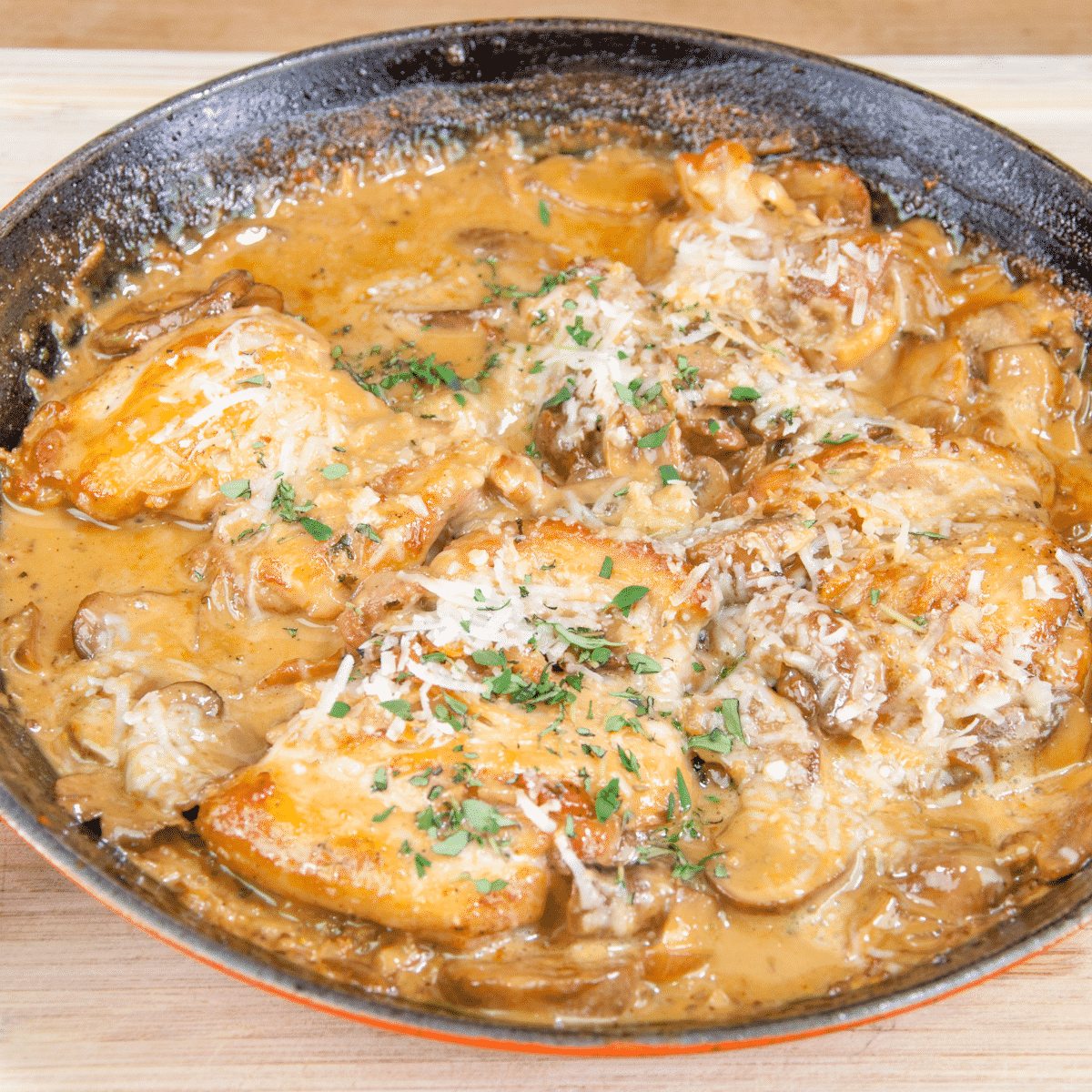 Creamy sherry and thyme chicken thighs. A wonderfully mouthwatering and delicious recipe. Add in wild mushrooms and you have one very special dish. Yum! | theyumyumclub.com