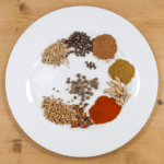 Aromatic spice-rubbed roast lamb Marrakesh style. 11 fragrant spices go into this scrummy recipe. The aroma of a Marrakesh Bazaar in your own kitchen. Yum! | theyumyumclub.com