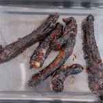 Place the cooked ribs in a roasting tray. Chinese sticky hoisin chilli ribs. Perfect pork spare rib. Yum! Yum! | theyumyumclub.com