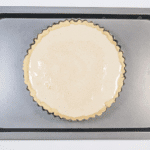 School Pudding Gypsy Tart. Fill the base | https://theyumyumclub.com/2019/05/23/school-pudding-gypsy-tart/