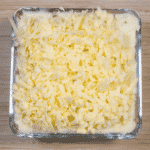 Cheddar topped shepherd's pie. Add the grated cheese | https://theyumyumclub.com/2019/05/16/cheddar-topped-shepherds-pie/