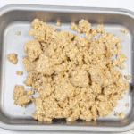 Tip the flapjack mixture into a baking tray | https://theyumyumclub.com/2019/06/01/extra-soft-and-chewy-flapjacks/