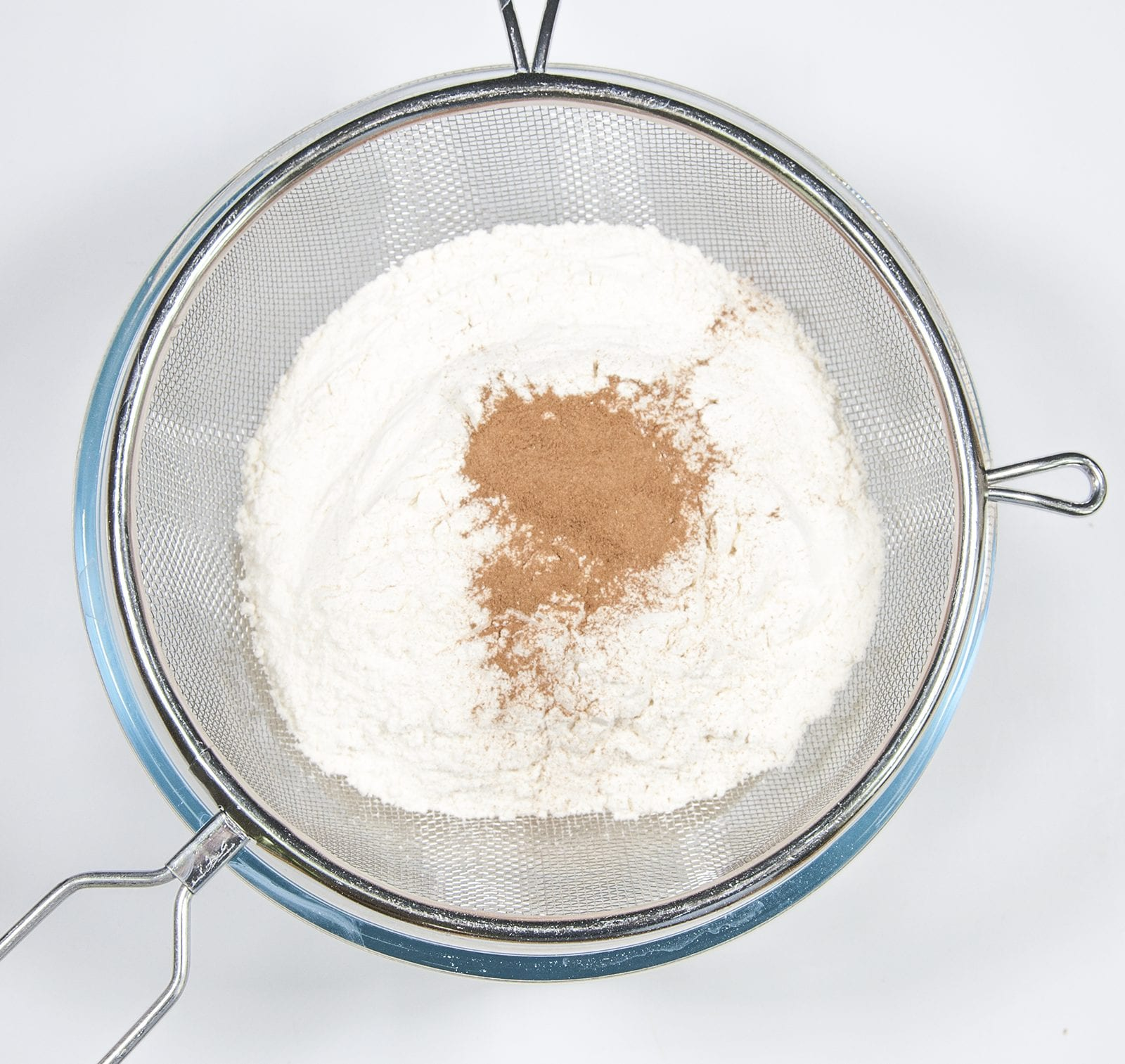 Sieve the flour and cinnamon. Humble Hummingbird Cake With Sweet Pecan Dust | https://theyumyumclub.com/2019/06/05/humble-hummingbird-cake-sweet-pecan-dust/