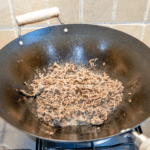 Pan-fry the ground beef | https://theyumyumclub.com/2019/07/22/ho-chi-minh-surf-turf/