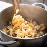 Add the cooked pasta and stir to combine.