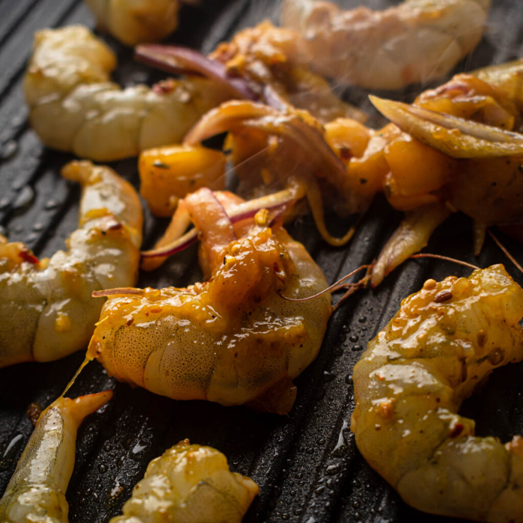 cook the prawns until sticky and fully cooked.
